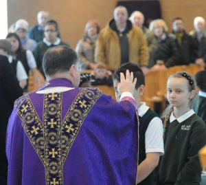 Lansing church celebrates Ash Wednesday Mass