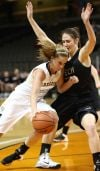 Purdue Calumet's Cassidy Deno is guarded by Oregon Tech's Tess Armstrong during Wednesday's first round of NAIA Division II Tournament at the Tyson Events Center in Sioux City, Iowa.
