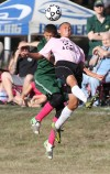 """Beecher's TJ Gibbons battles on a header with Grant Park's David Para in the first half of Thursday's  annual """"Pink Game"""" in honor of local cancer survivors."""