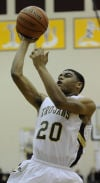 Chesterton's Niles Dilosa shoots over Michigan City's Anthony Simmons (not pictured) during Friday's game.