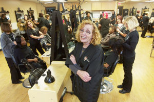 Businesswoman celebrates success by giving back to community