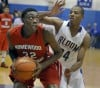 Bloom Township's Nhyree Mitchell applies defensive pressure to Homewood=Flossmoor's Tai Odiase
