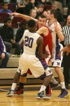 Portage's Jacob Bearss is sandwiched between Merrillville's B.J. Jenkins and Jake Raspopovich during Friday night's game.