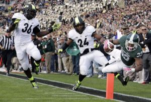 No. 8 Michigan St. holds off Purdue rally