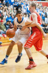 Lake Central senior forward Cory Dickelman attempts to drive around Munster senior forward Pat McCarthy during Saturday's Class 4A E.C. Central Sectional championship.