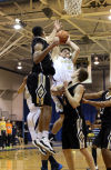 Bishop Noll's Michael Jakubielski pulls down a rebound against Griffith on Tuesday night.