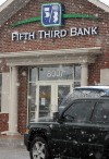 Munster, Lansing bank robberies tied