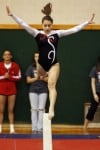 Portage's Danielle Solis performs her routine on the balance beam