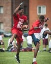 T.F. South's Efie Ovie, left, celebrates after a catch Saturday during the 7 on 7 tournament at Richards.