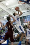 Lake Central senior Tyler Ross takes a shot during the first quarter of Friday night's game against Chesterton.