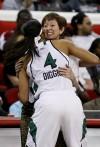 Notre Dame coach Muffet McGraw hugs Skylar Diggins