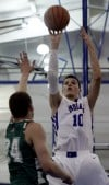 Lake Central's Mike Miklusak shoots over Valparaiso's Quentin Palmer 