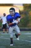 Lake Central quarterback Alec Olund looks for a receiver in Friday night's scrimmage against Morton.