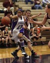 Merrillville's Christina Brown reaches for a loose