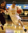 Valparaiso University's Matt Kenney drives against Loyola's Joe Cfisman, a Munster grad,