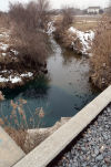 Local and state officials are investigating the release of a blue dye into the Little Calumet River over the weekend, officials said.