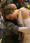 Ryan Broekhoff gets a hug from Valparaiso V.P. Michael Joseph after the Crusaders defeated Wright State in the Horizon League men's basketball tournament championship game.