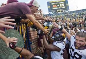 BIG TEN ROUNDUP: Minnesota takes Little Brown Jug from Michigan