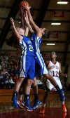 West Side player Lexus Fox comes up with a rebound against Lake Central's Chrissy Addison and Jessica Bell 