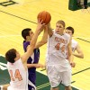 Valparaiso's Brody Wilson, left, and John Mosser combine to stop a shot attempt by Merrillville's Jake Raspopovich on Friday.
