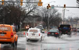 Flooded roads, swollen rivers, lightning strikes as storms sock region