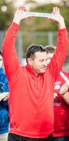 Crown Point coach Chris Koreniewski holds up the regional plaque Wednesday