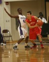 Merrillville's Jelani Pruitt guards Munster's Adam Ostoich