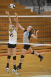 Lowell's Karoline Chraponski, right, tries to hit over the block attempt of Higland's Brittany Raab on Thursday at the Class 4A Munster Sectional.