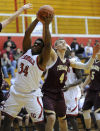E.C. Central's Madison Hawkins shoots around Chesterton's Jacob Weber