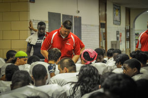 Despite court battles from coast to coast, many area football coaches still do pregame prayers