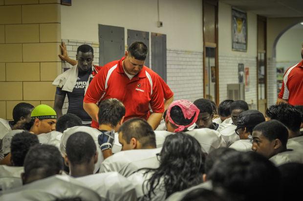 Despite court battles from coast to coast, many area football coaches still do pregame prayers