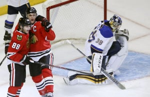Kane, Toews on same line as Hawks get more forward-thinking