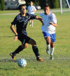 Bishop Noll's Mark Sullivan, left, and Boone Grove's Nick Azevedo battle for control of the ball Thursday.