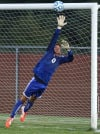 LaPorte goalkeeper Jon Williams defends against a Crown Point shot