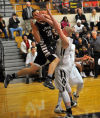 Griffith's Chad Noldin fouls Lowell's Zach VanHook on Tuesday night in a NCC matchup.