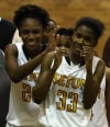 Seton Academy's Bri Gamble pats teammate Ebony Bailey on the head after they beat Illiana Christian in the Class 2A regional on Thursday night.