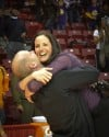 Marian Catholic coach Annie Byrne is hugged by her husband, Kieran, moments after Kauai Bradley's game-winning shot