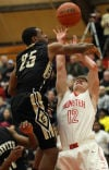 Munster's Kevin Schlotman is fouled by Griffith's Rodney Lewis at Munster.