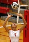 Crown Point's Meagan Fajman sets during Saturday night's Class 4A Crown Point Sectional championship.