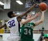 Valparaiso's Quentin Palmer goes up for a layup against Merrillville's Zoran Talley on Saturday.