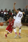 E.C. Central's Hyron Edwards drives around Bowman Academy's Justin King on Tuesday night.