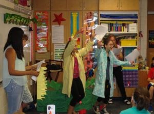 Middle schoolers perform scripts for younger students