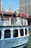 Desirée Rogers Cracking Champagne Cottle for Christening of Chicago's First Lady Cruises new Chicago's Classic Lady.