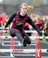 River Forest's Bryanna Kaehler clears a hurdle