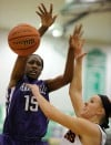 Merrillville's Victoria Gaines is fouled during Saturday's Class 4A Valparaiso Regional championship.