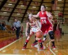 Munster's Natalie Vellutini, left, is pressured by Crown Point's Taylor Equihua