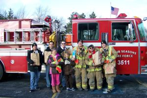 LOFS firefighters collecting food for the needy