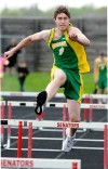 Brad Mcginley of Morgan Twp. leaps the hurdles
