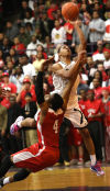 Marian Catholic's Tyler Ulis shoots against Homewood-Flossmoor's Bradley Terrence in Marian's win in the Class 4A Thornton Sectional final.