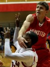 E.C. Central's Hyron Edwards takes a slap in the face from Munster's Mike Schlotman